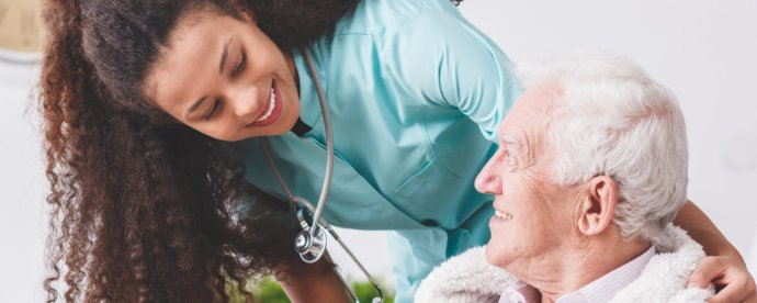 female-medical-professional-assisting-senior-man