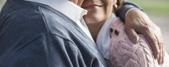 woman-hugging-her-elderly-father-facing-the-evening-sun