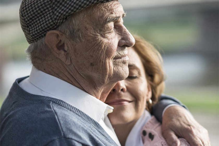 Woman hugging her elderly father